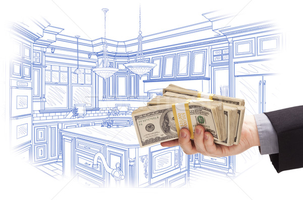 Hand Holding Cash Over Custom Kitchen Design Drawing Stock photo © feverpitch