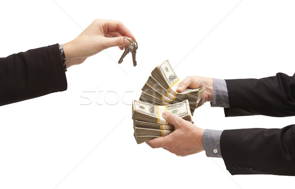 Handing Over Thousands of Dollars for House Keys on White Stock photo © feverpitch