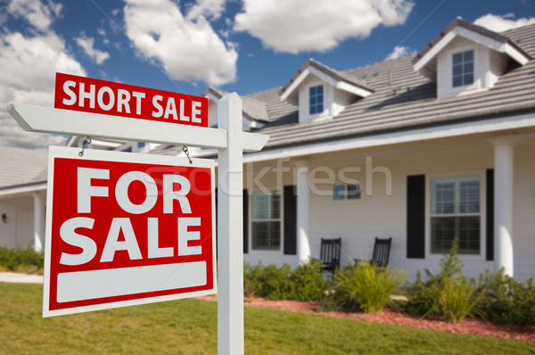 Stock photo: Short Sale Real Estate Sign and House - Left