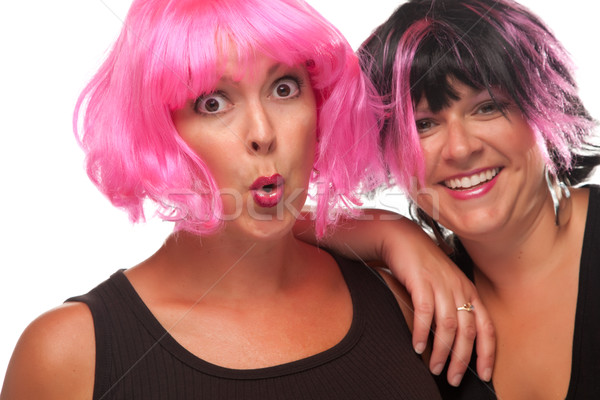 Portrait of Two Pink And Black Haired Smiling Girls Stock photo © feverpitch