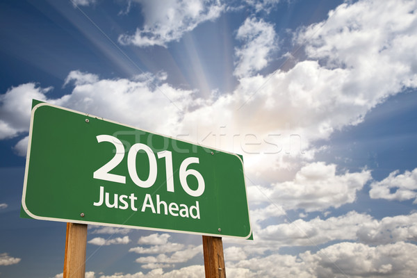 2016 Just Ahead Green Road Sign Against Clouds Stock photo © feverpitch