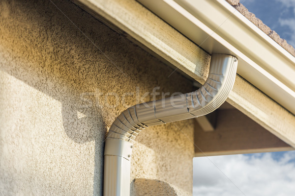 House with New Seamless Aluminum Rain Gutters. Stock photo © feverpitch