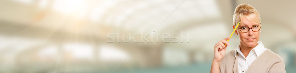 Banner of Beautiful Expressive Student or Businesswoman with Pen Stock photo © feverpitch