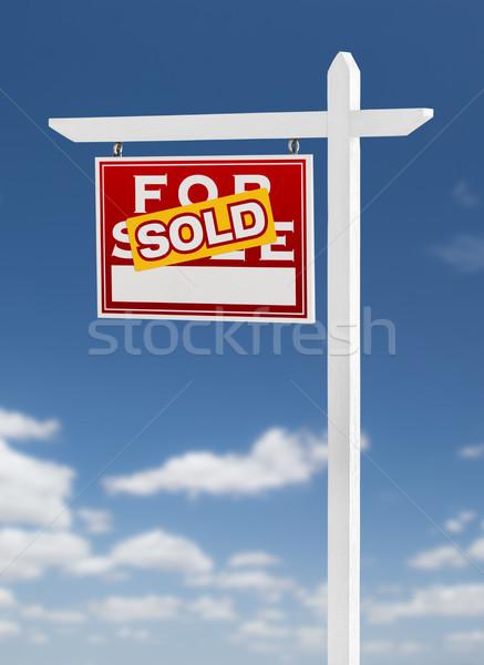 Venduto vendita immobiliari segno cielo blu Foto d'archivio © feverpitch