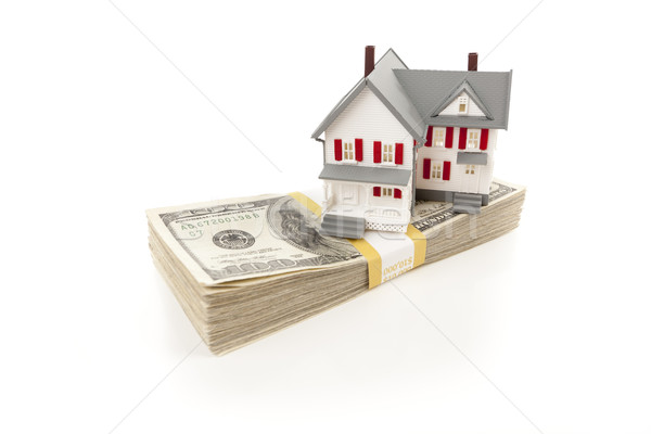 Small House on Stack of Hundred Dollar Bills Stock photo © feverpitch