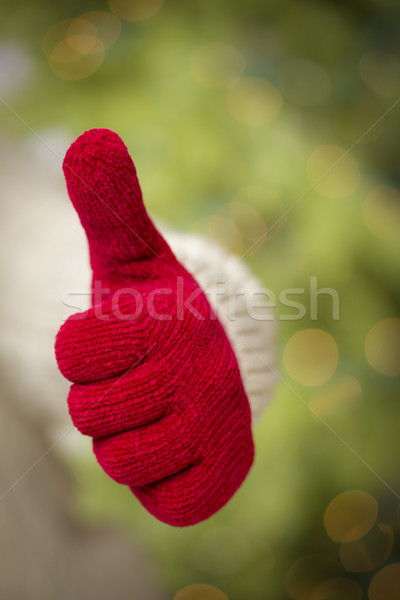 Woman Wearing Red Mittens Holding Out Thumbs Up Hand Sign Stock photo © feverpitch