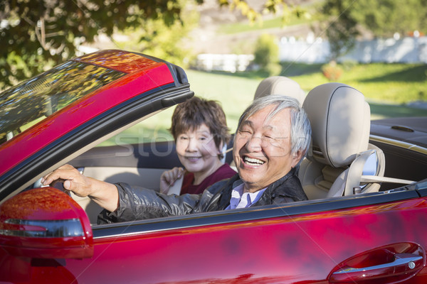 Happy Chinese Couple Enjoying An Afternoon Drive in Their Conver Stock photo © feverpitch
