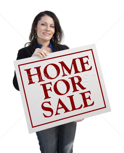 Hispanic Woman Holding Home For Sale Real Estate Sign Stock photo © feverpitch