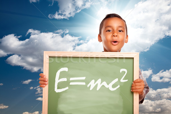 Proud Hispanic Boy Holding Chalkboard with Theory of Relativity Stock photo © feverpitch