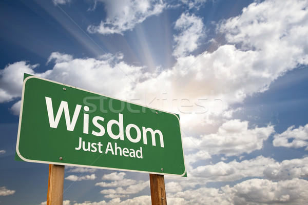 Wisdom Green Road Sign Over Clouds Stock photo © feverpitch