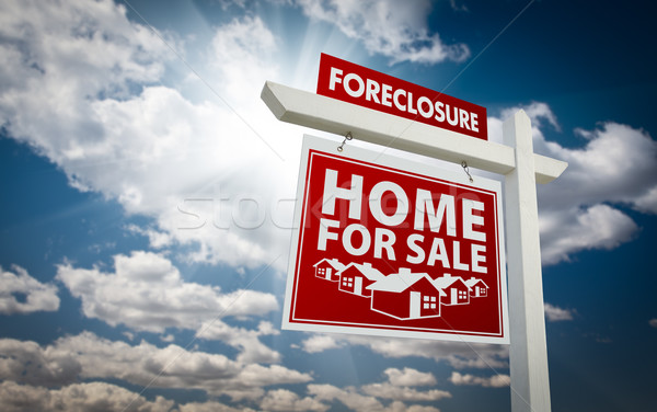 Red Foreclosure Home For Sale Real Estate Sign Over Clouds and S Stock photo © feverpitch