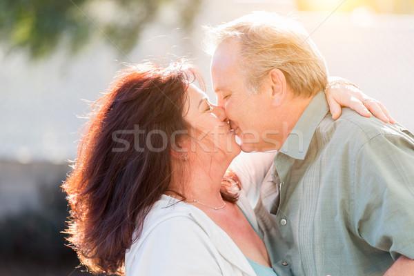 Középkorú pár élvezi romantikus lassú tánc Stock fotó © feverpitch