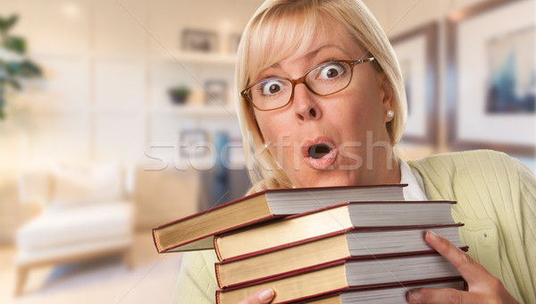 Beautiful Expressive Student or Businesswoman with Books in Offi Stock photo © feverpitch
