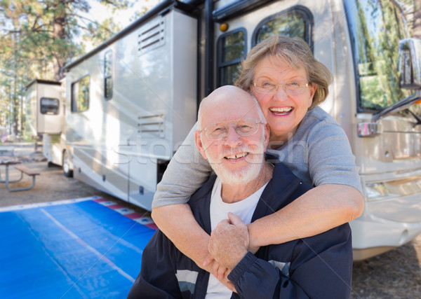 Senior Couple In Front of Their Beautiful RV At The Campground. Stock photo © feverpitch