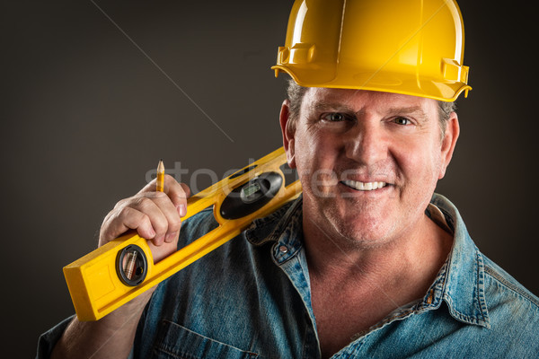 Smiling Contractor in Hard Hat Holding Level and Pencil With Dra Stock photo © feverpitch