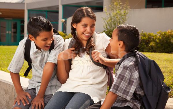 Stockfoto: Latino · broers · zus · praten · klaar · school