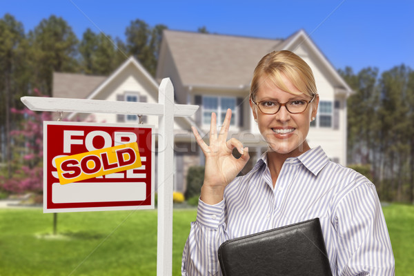 Real Estate Agent in Front of Sold Sign and House Stock photo © feverpitch