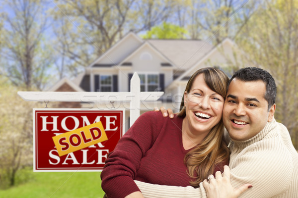 Stock photo: Couple in Front of Sold Real Estate Sign and House