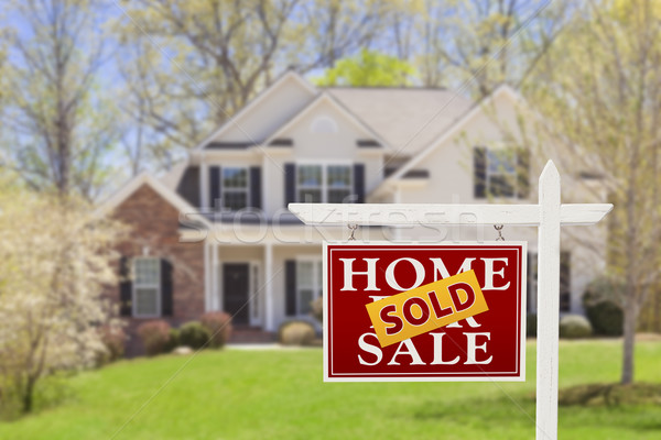 Stock photo: Sold Home For Sale Real Estate Sign and House