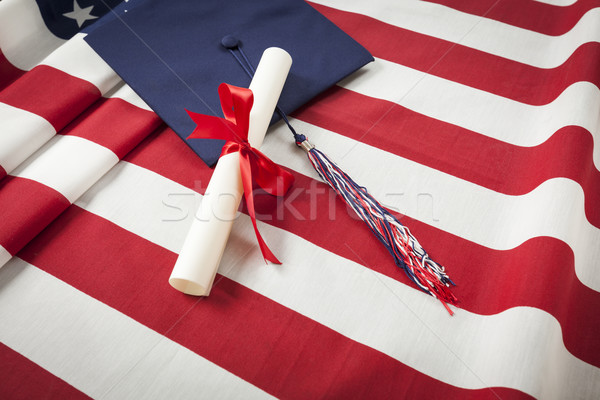 Graduation Cap and Diploma Resting on American Flag Stock photo © feverpitch