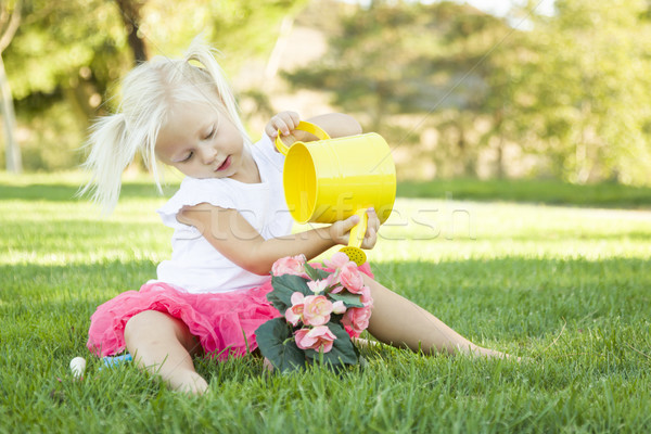 Stock photo: Little Girl Playing Gardener with Her Tools and Flower Pot