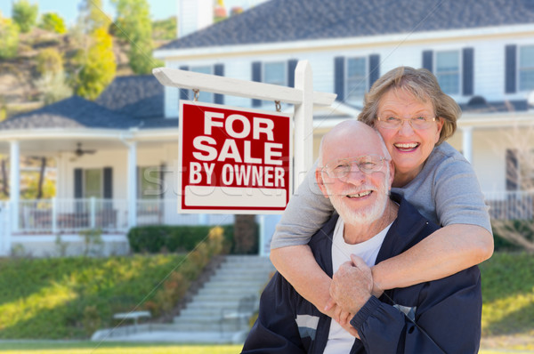Senior Adult Couple in Front of Real Estate Sign, House Stock photo © feverpitch