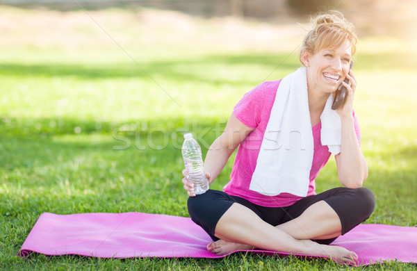 Young Fit Adult Woman Outdoors with Towel and Water Bottle on Yo Stock photo © feverpitch