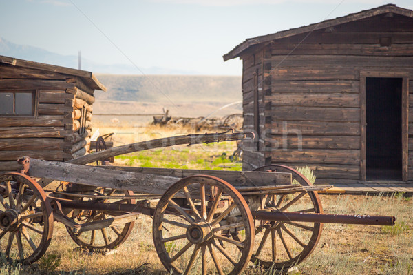 Abstract of Vintage Antique Wood Wagon and Log Cabins. Stock photo © feverpitch