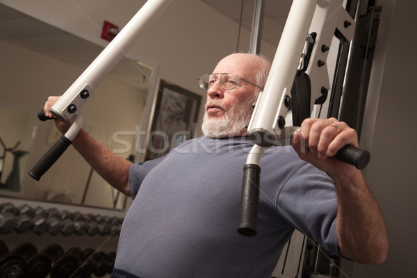 Senior Adult Man Working Out in the Gym. Stock photo © feverpitch