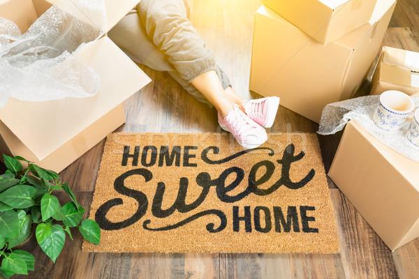 Woman Wearing Sweats Relaxing Near Home Sweet Home Welcome Mat,  Stock photo © feverpitch