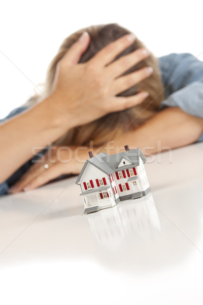 Woman with Head in Hand Behind Model Home Stock photo © feverpitch