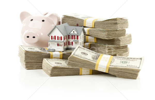 Small House and Piggy Bank with Stacks Money Stock photo © feverpitch