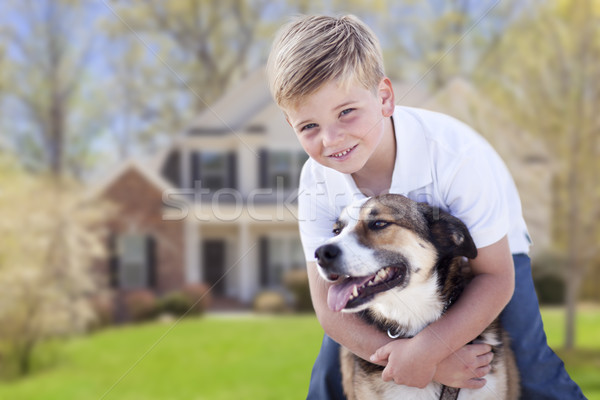 Young Boy and His Dog in Front of House Stock photo © feverpitch