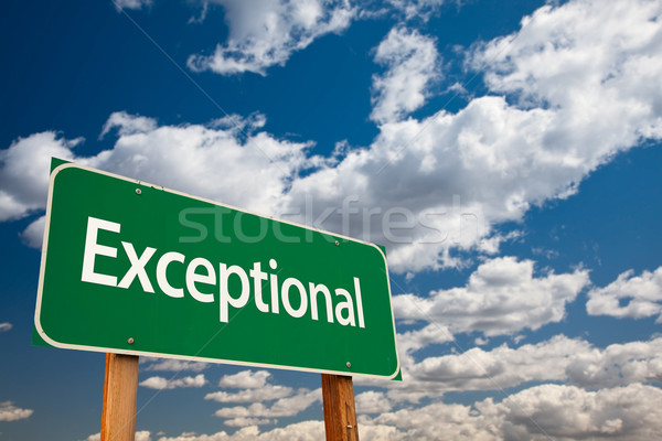 Exceptional Green Road Sign with Sky Stock photo © feverpitch
