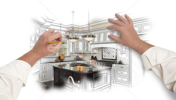 Male Hands Sketching Custom Kitchen with Photo Showing Through Stock photo © feverpitch