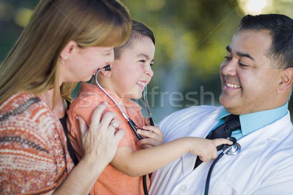 Mixed Race Boy, Mother and Doctor Having Fun With Stethoscope Stock photo © feverpitch