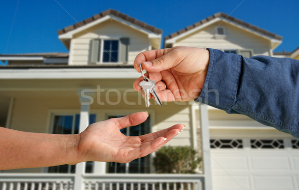 Handing Over the House Keys in Front of New Home Stock photo © feverpitch