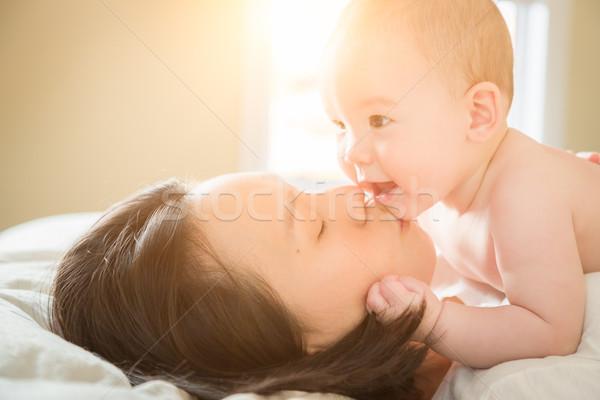 Félvér kínai kaukázusi baba fiú fektet Stock fotó © feverpitch e0f9ff6ed9
