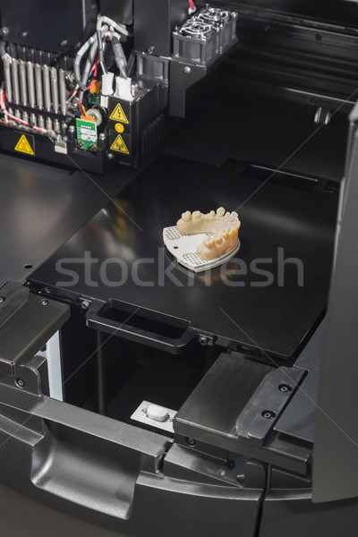 Stock photo: 3D Printer With Finished 3D Printed Dental Implant Bridge