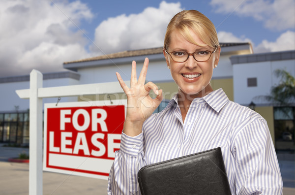 Businesswoman In Front of Office Building and For Lease Sign Stock photo © feverpitch