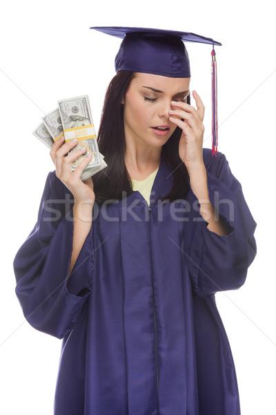 Hangsúlyos női diplomás tart száz dollár bankjegyek Stock fotó © feverpitch