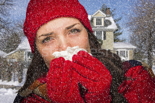 Sick Woman In Snow Blowing Her Sore Nose With Tissue Stock photo © feverpitch