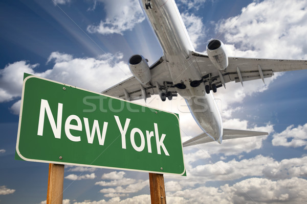New York Green Road Sign and Airplane Above Stock photo © feverpitch