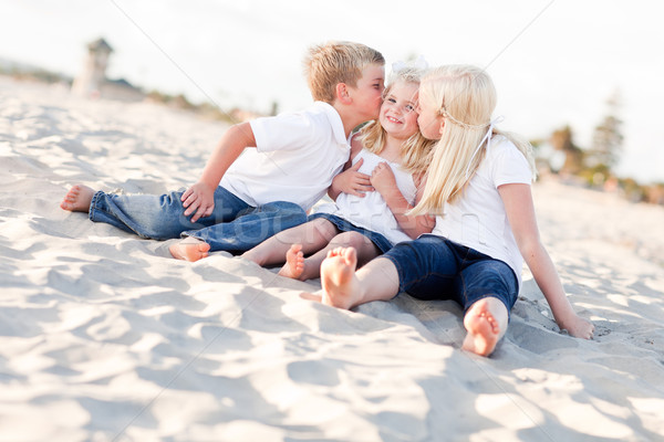 Adorable Sibling Children Kissing the Youngest Stock photo © feverpitch