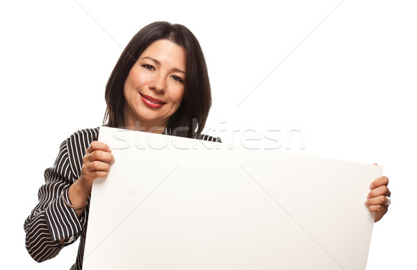Attractive Multiethnic Woman Holding Blank White Sign Stock photo © feverpitch