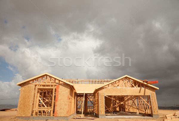 Abstract Home Construction Site and Ominous Clouds Stock photo © feverpitch