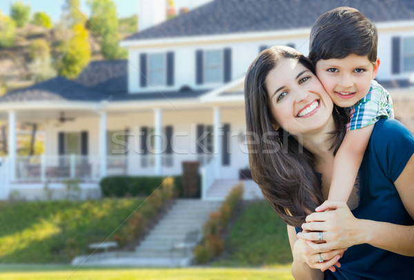Young Mother and Son In Front Yard of Beautiful Custom House. Stock photo © feverpitch
