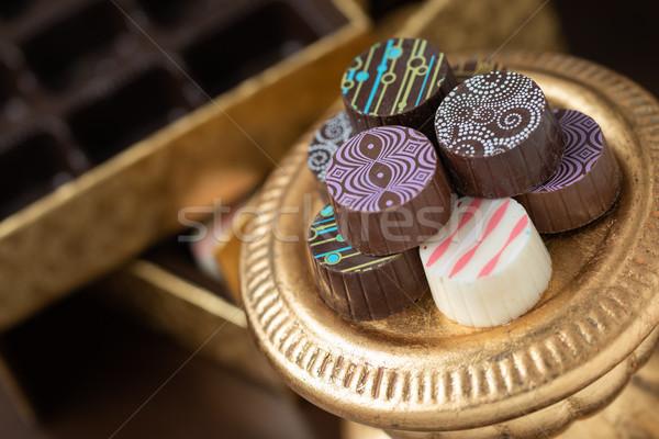 Artisan Fine Chocolate Candy On Gold Pillar Serving Dish Stock photo © feverpitch