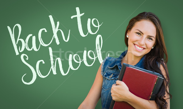 Back To School Written On Chalk Board Behind Mixed Race Young Gi Stock photo © feverpitch