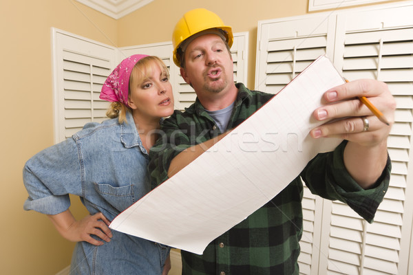 Contractor in Hard Hat Discussing Plans with Woman Stock photo © feverpitch